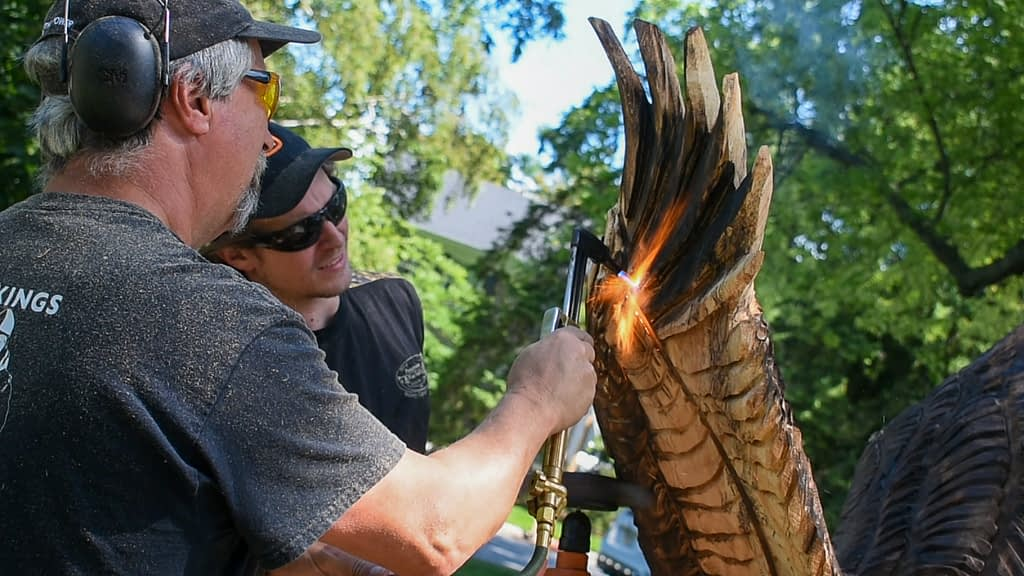 wood burning a chainsaw carving